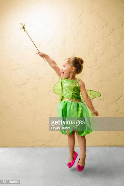 girl wearing green fairy costume with wand - princess stock pictures, royalty-free photos & images