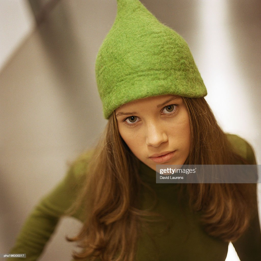 Girl wearing hat, looking at camera, portrait. : Stockfoto