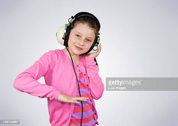 A girl wearing headphones pretending to be a DJ