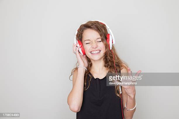 Girl wearing headphones with eyes closed