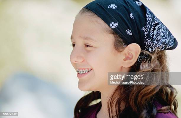 Girl (12-13 years) wearing headscarf, side view