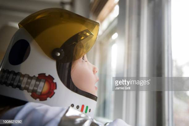 girl wearing helmet - astronaut stock-fotos und bilder
