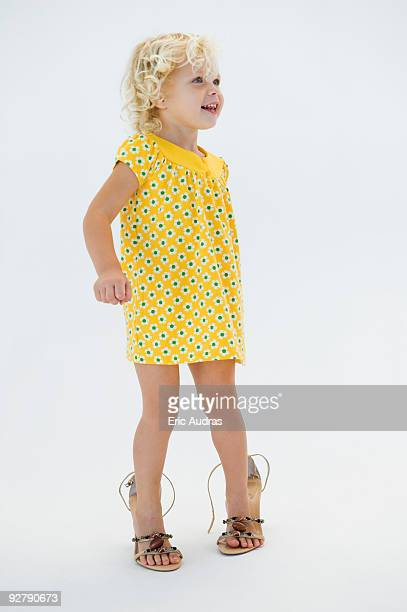 Girl wearing high heels and smiling