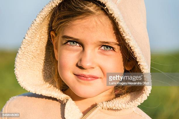 girl wearing hooded jacket, portrait - alexandra dost stock-fotos und bilder