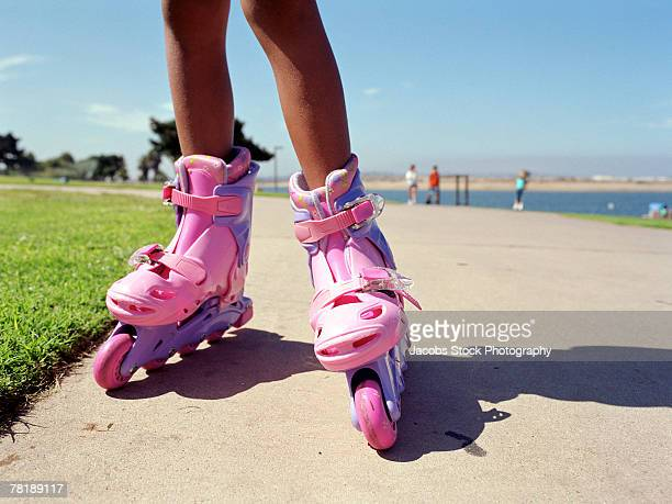 girl wearing inline skates - girls open legs stock photos and pictures
