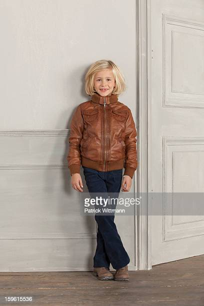 Girl wearing jacket indoors