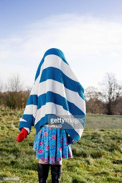 Girl wearing oversized jumper, obscured face