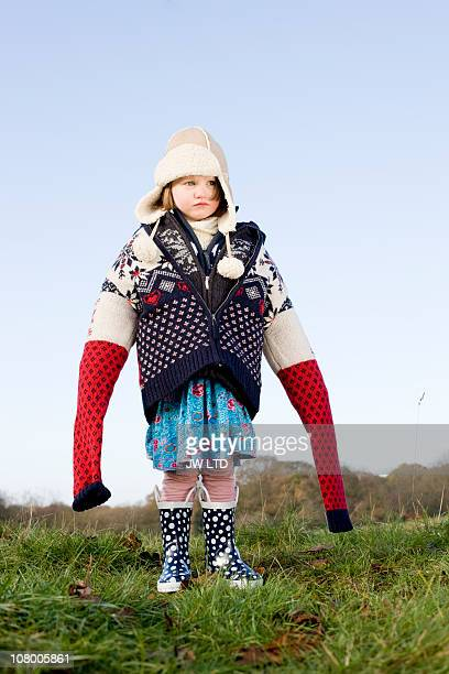 Girl wearing oversized wooly jumpers