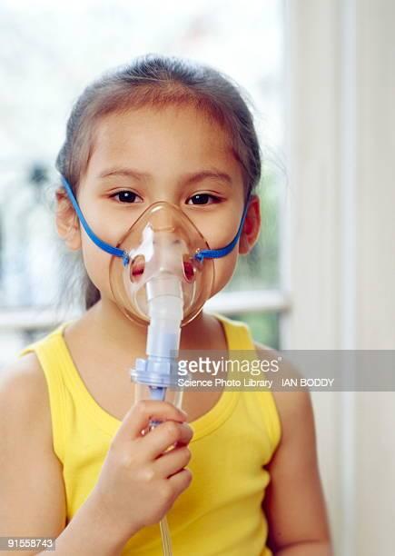 Girl (5-6) wearing oxygen mask