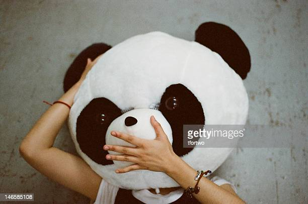 girl wearing panda mask - panda animal stock photos and pictures