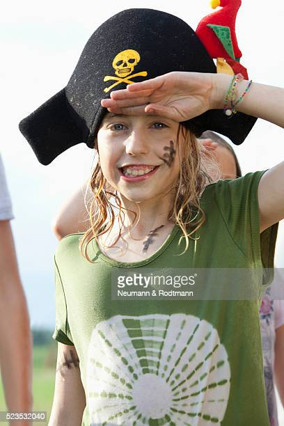 girl (7-9) wearing pirate hat and saluting - saluting stock pictures, royalty-free photos & images