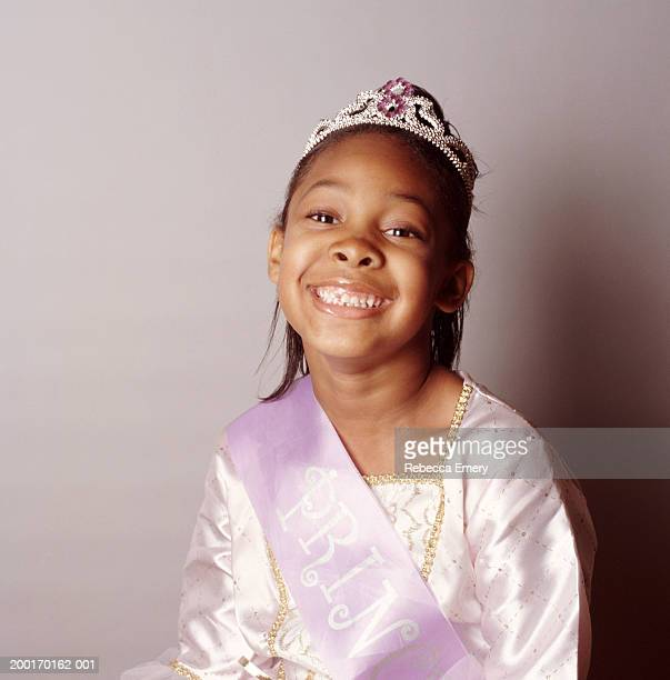 girl (5-7) wearing princess costume, smiling, portrait - emery stock photos and pictures