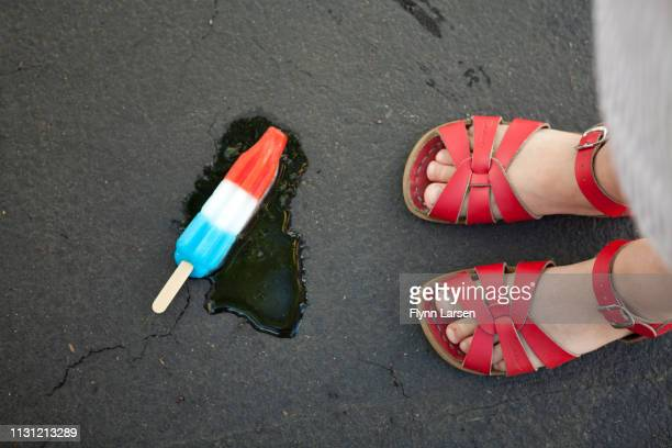 girl wearing red sandals with ice lolly on floor - white shoe stock pictures, royalty-free photos & images