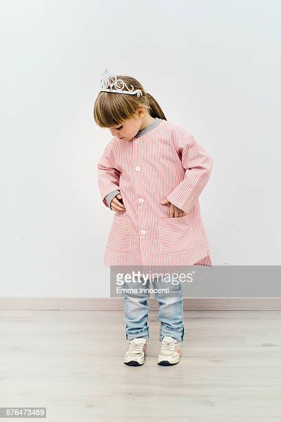 girl wearing red school apron and silver crown - school girl shoes stock pictures, royalty-free photos & images