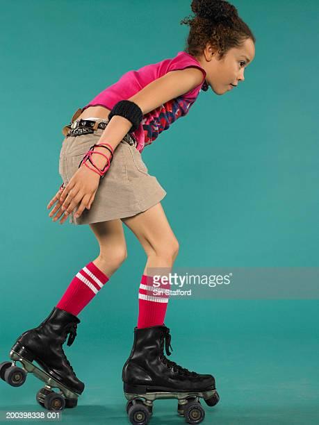 Girl (5-7) wearing rollerskates