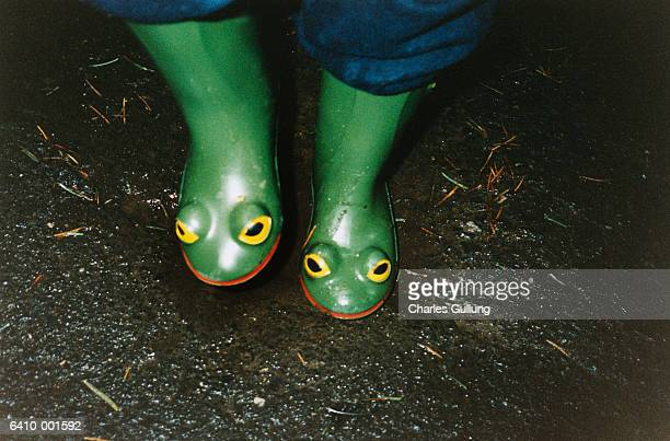 Girl Wearing Rubber Frog Boots
