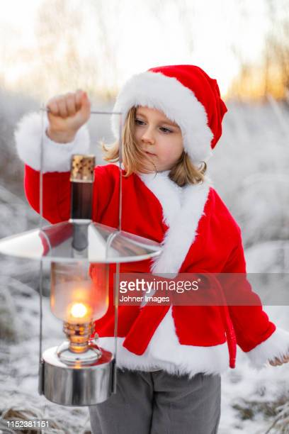 girl wearing santa clothes at winter - banquet stock pictures, royalty-free photos & images