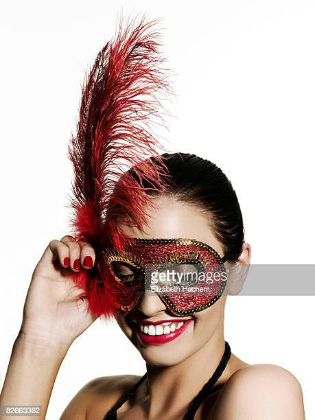 girl wearing sequinned mask, looking down