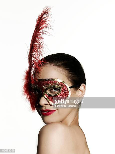 Girl wearing sequinned mask looking to camera