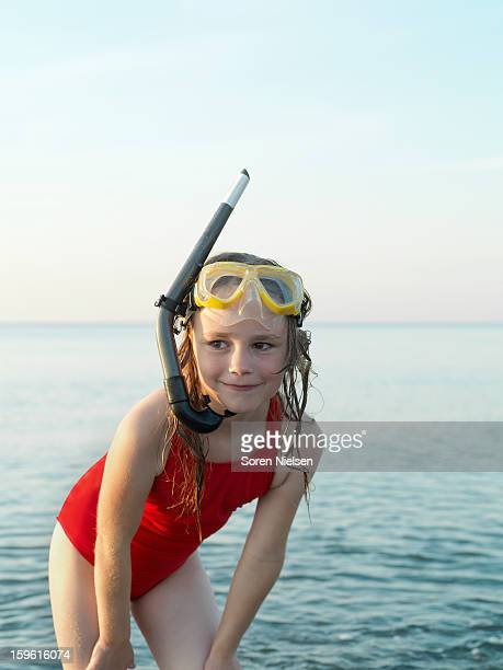 Girl wearing snorkel and mask in water