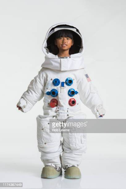 girl wearing space suit - astronaut stock pictures, royalty-free photos & images