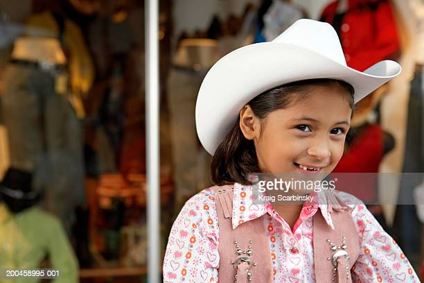 girl (8-10) wearing stetson, smiling - cowgirl hairstyles stock photos and pictures