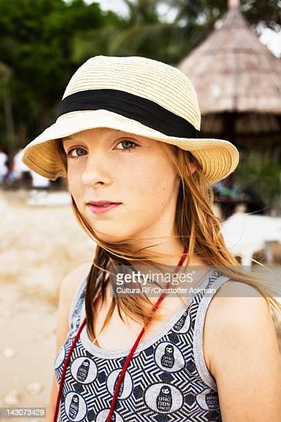 Girl wearing straw hat on beach