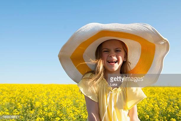 Girl wearing sun hat outdoors