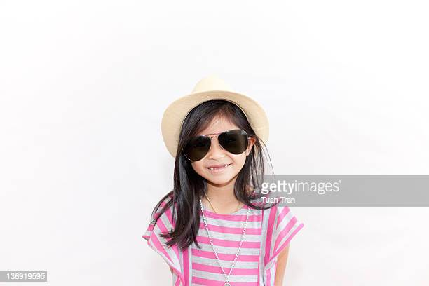 Girl wearing sunglasses and hat