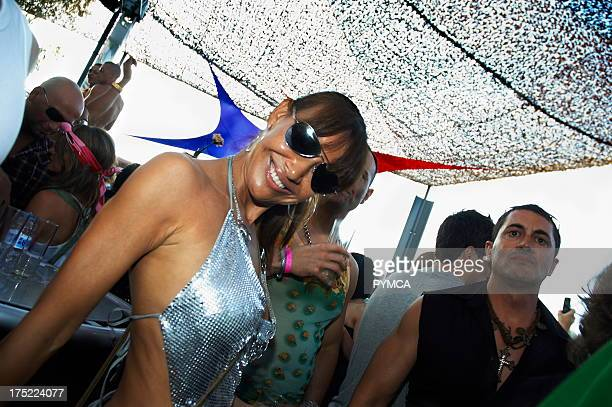Girl wearing sunglasses and silver dress smiling Space opening party Ibiza 2007
