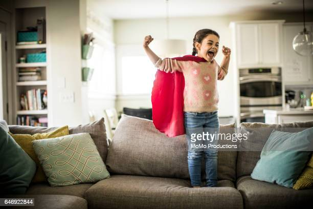 girl (7yrs) wearing superhero cape, indoors - capuz - fotografias e filmes do acervo