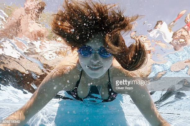 girl wearing swim goggles underwater - little girl cleavage stock photos and pictures