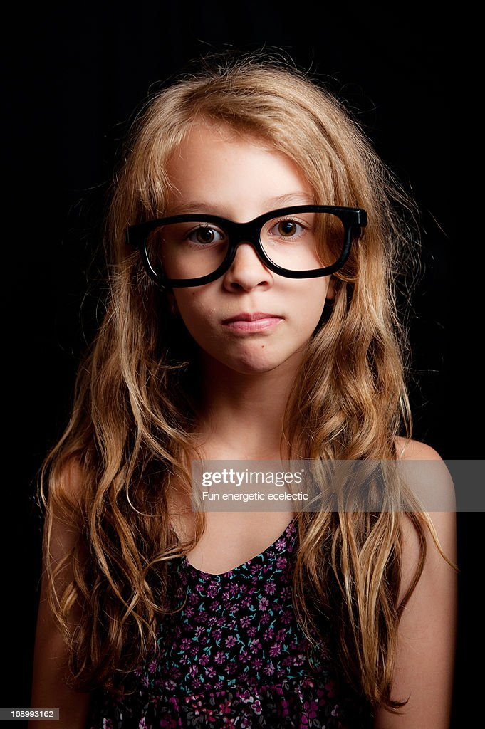 Girl wearing thick black glasses : Stock Photo