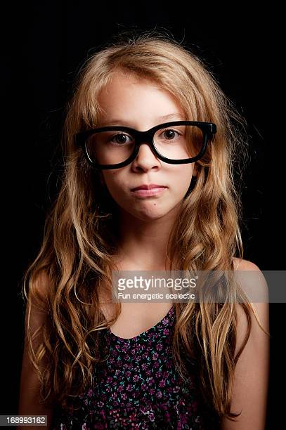 girl wearing thick black glasses - thick girls stock photos and pictures