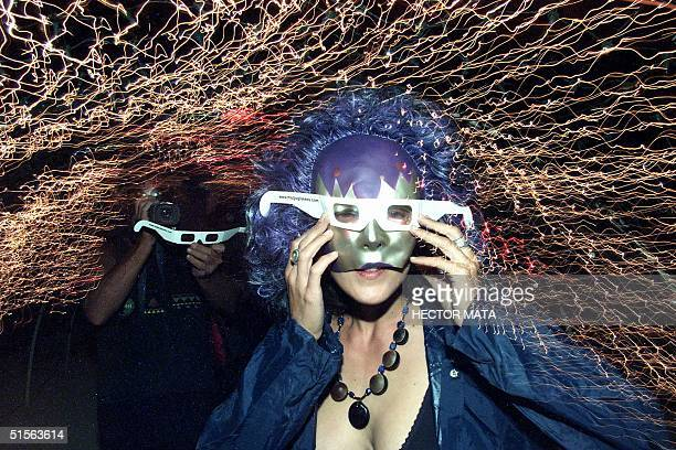 A girl wearing three dimensional glasses enters a tunnel of lights during the Burning Man Festival at Black Rock City desert in Nevada 29 August 2000...