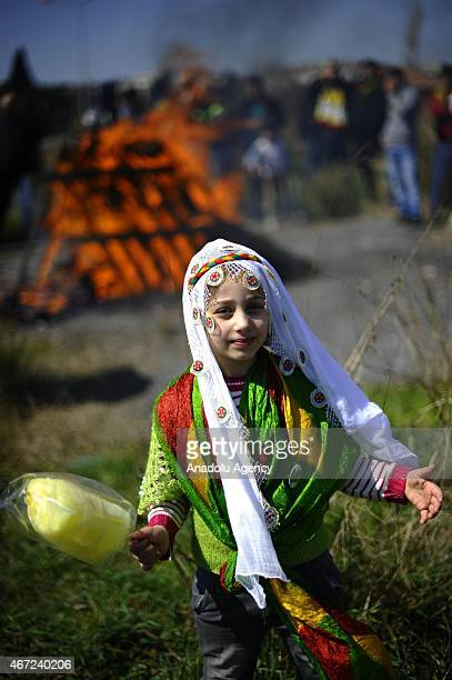 A girl wearing traditional clothes is seen during the Newroz celebrations organized by Peoples Democratic Party at Kazlicesme Square in Istanbul...