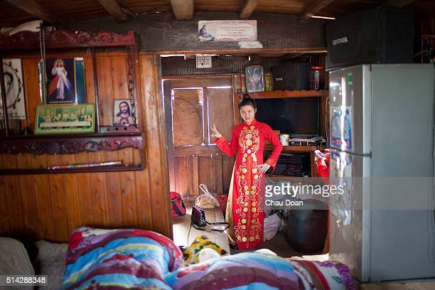 Girl wearing Vietnam traditional dress called Ao Dai getting ready for an wedding in Nguyet Duc floating village Bac Ninh province which is about 50...