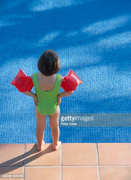 girl wearing water wings - arm band stock pictures, royalty-free photos & images