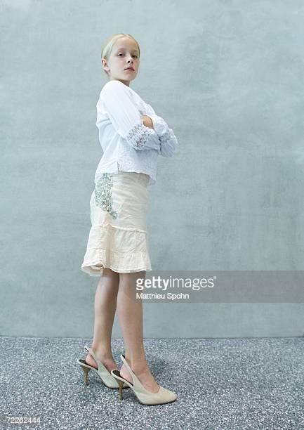 Girl wearing women's shoes