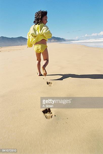 Girl Wearing Yellow Hooded Top on the Beach