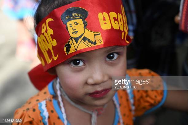TOPSHOT A girl wears a bandana with a portrait of General Aung San as she visits the Ministers' Building formerly known as the Secretariat Building...