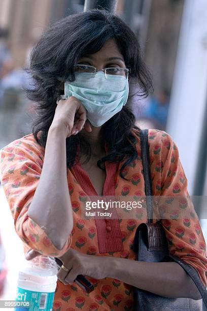 A girl wears a protection mask in Ram Manohar Lohia Hospital in New Delhi on Thursday August 20 2009 The national capital reported its first Swine...