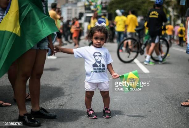 A girl wears a Tshirt depicting Brazilian farright presidential candidate Jair Bolsonaro in Rio de Janeiro Brazil on October 21 2018 Barring any...