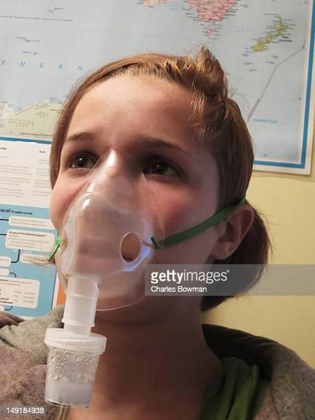 Girl wears nebuliser mask after asthma attack