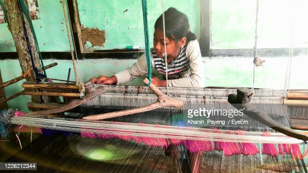 girl weaving loom in workshop - child labor stock pictures, royalty-free photos & images