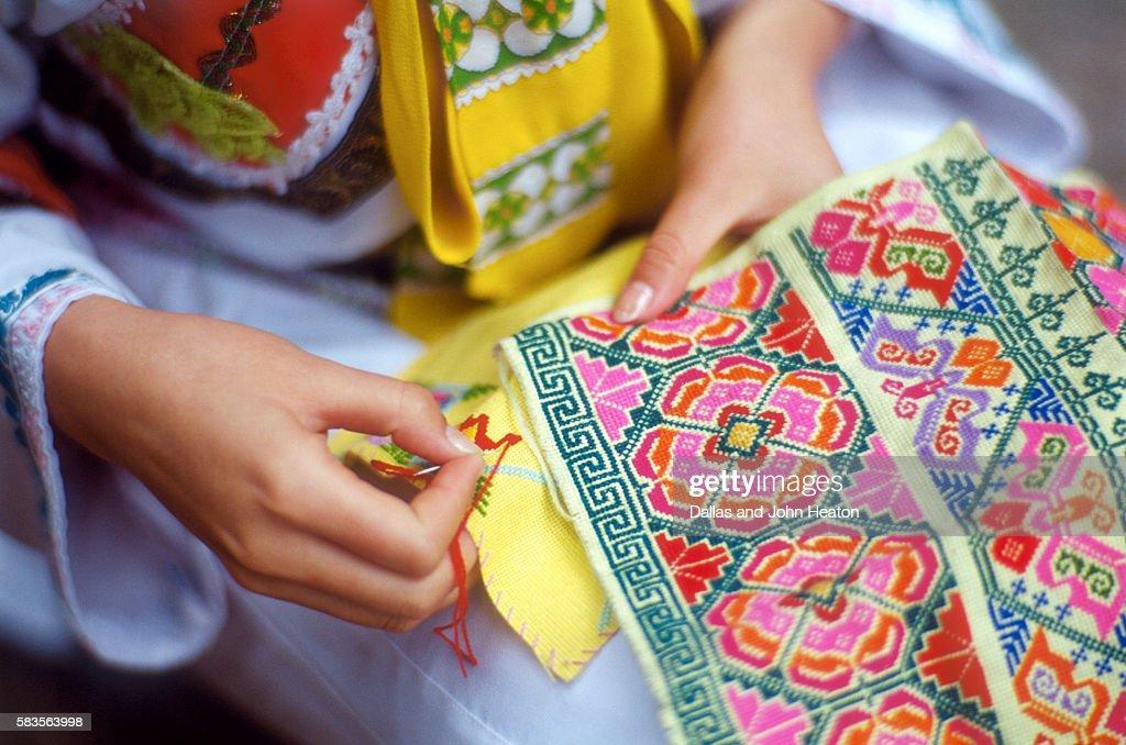 Girl weaving Nax, China : Stock Photo