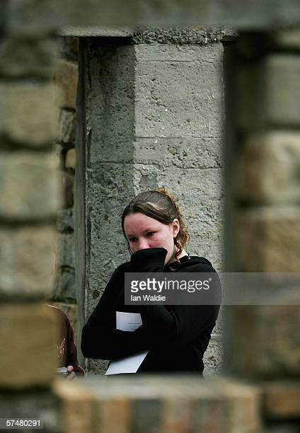 A girl weeps on the site which was formerly the Broad Arrow cafe during a commemoration service to mark the 10th aniversary of the massacre April 28...