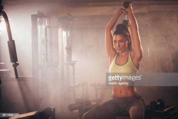 girl weightlifting - yoga pants stock photos and pictures
