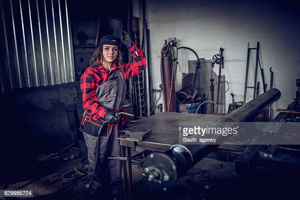 Girl welder in workshop