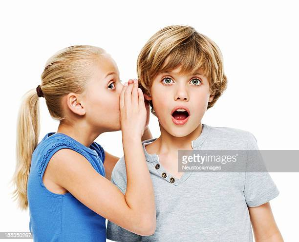 Girl Whispering a Secret to Her Brother - Isolated